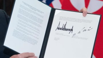 180612073059-trump-kim-summit-signing-document-exlarge-169