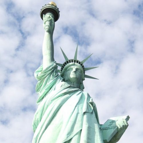 Statue Cruises - Home Slider 5 - Statue Cruises in Front of Ellis Island (5)